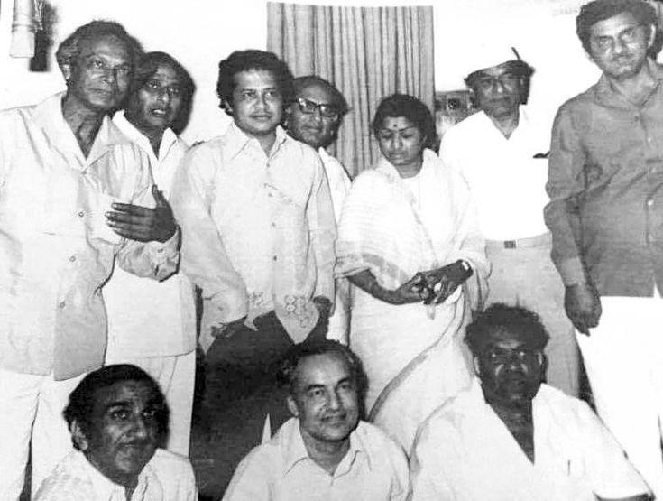 Standing (L to R) Naushad, Subhodh Mukherjee, Lakshmi Kant, Lata Mangeshkar,V. Shantaram, Anand Bakshi. Sitting (L to R) Raj Khosla, Mukesh & Sriram Vora.