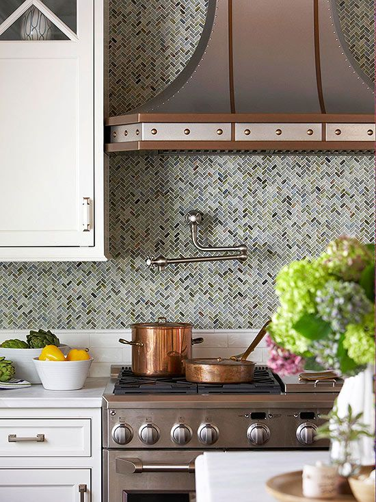 Tiny glass mosaics in a herringbone pattern introduce soft blues and grays to the white kitchen: http://www.bhg.com/kitchen/color-schemes/neutrals/white-kitchens-we-love/?socsrc=bhgpin052314cozywhitekitchen&page=9