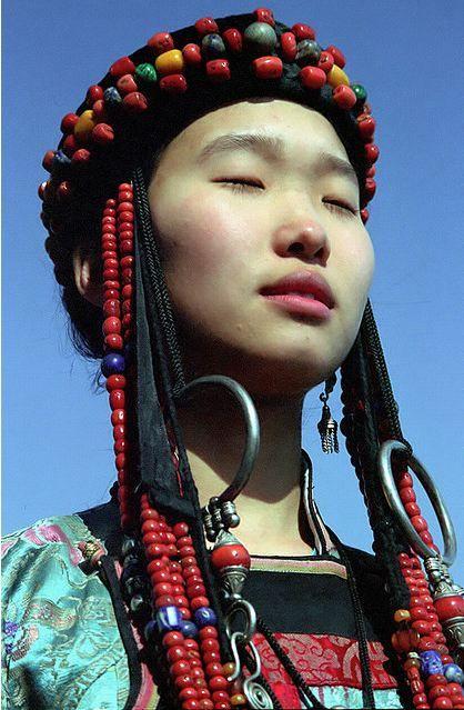 Young Buryat girl in traditional dress, Lake Baikal, Buryatia, Russia.