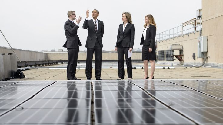 """""""Look,"""" Obama appears to be saying, """"the invisible hand of the market is guiding us toward a low-carbon future."""" (Photograph by Brendan Smialowski 
