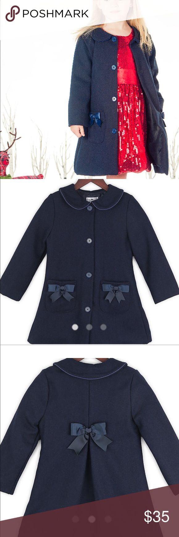 Joe-Ella Navy Blue Pea Coat PRODUCT FEATURES The classic design of this navy pea coat is accented with colour co-ordinated buttons, bows and piping around the Peter Pan collar. The combination of polyester and rayon make the coat feel like velvet while a pleat in the back gives this coat extra fulness, comfort and style.   Gently Used, smoke free home. Joe-Ella Jackets & Coats Pea Coats