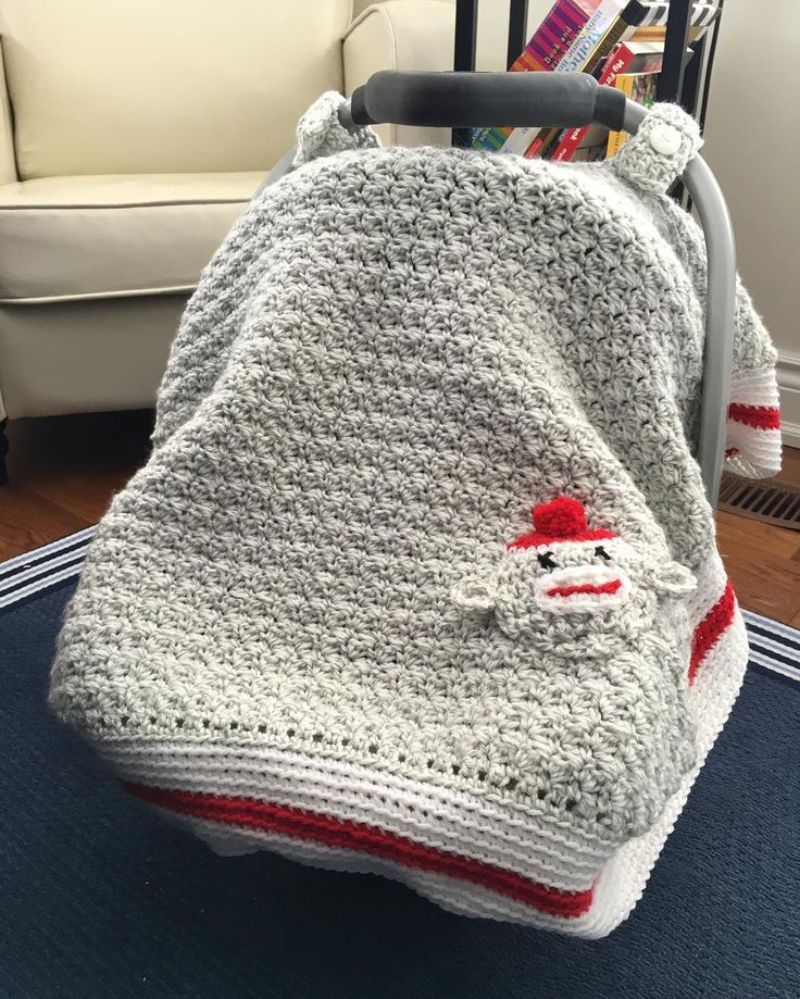 Crochet carseat canopy this one a sock monkey blanket