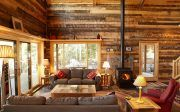 Gorgeous Small Cabin Ideas Decorating with Unfinished Wooden Coffee Tables and Grey Loveseat Sofa also Stacked Stone Table Lamp Alongside Wood Burning Metal Fireplace