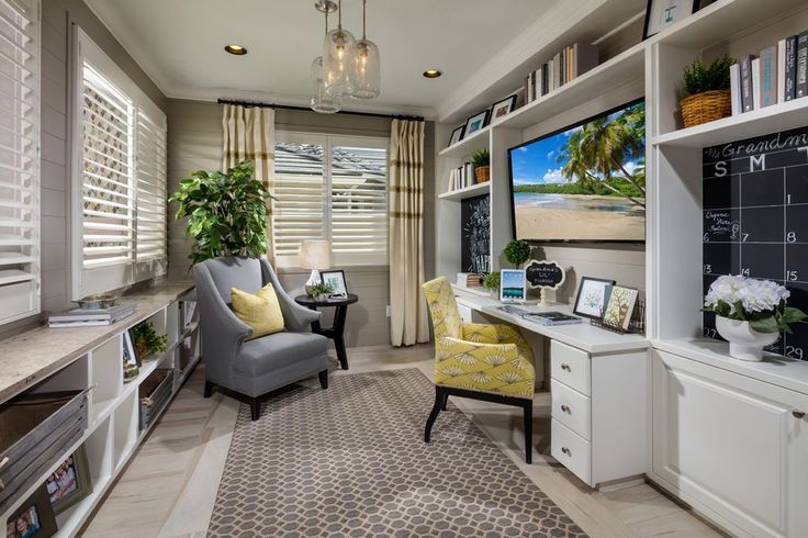 Traditional Home Office with Pendant Light, Carpet, Crown molding, Hardwood floors, Built-in bookshelf, High ceiling
