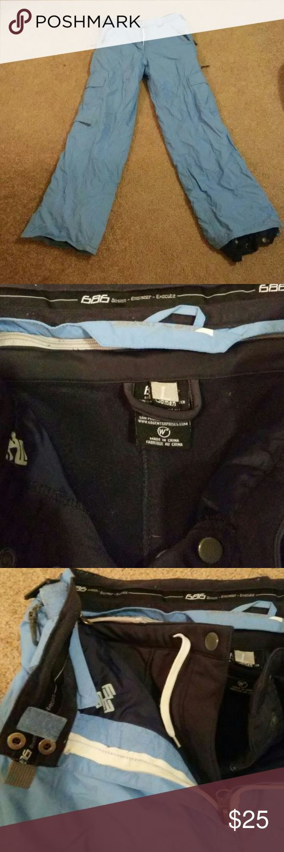 686 snowboard pants size L 686 snowboarding pants. Blue size large. These have been worn a lot and have a few defects to the bottoms where the binding meet the pants. Shown in photos. There is an inner layer that's super warm and can be removed. Still in excellent condition! Pants