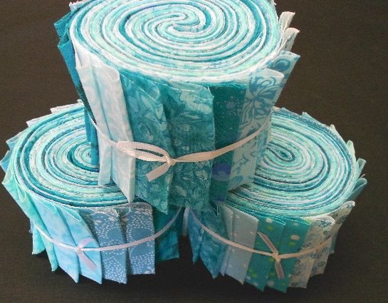 Aqua Jelly Roll Fabric Strips Turquoise Quilt Kit  by SEW FUN QUILTS - maybe turquoise and purple for ellie to try making a quilt :D