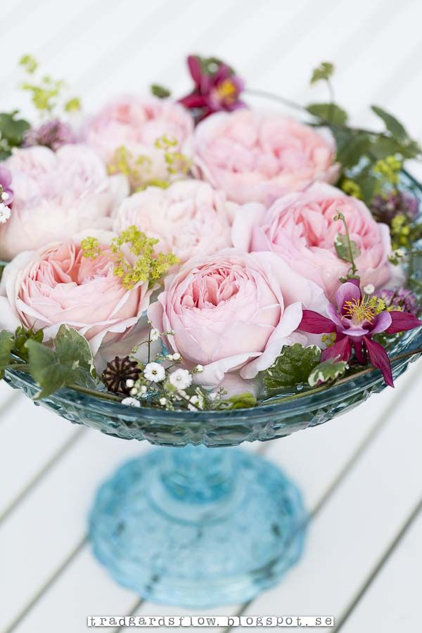 Lovely idea to put the flowers into a vintage candy dish -- from Garden Flow = tradgardsflow.blogspot.com