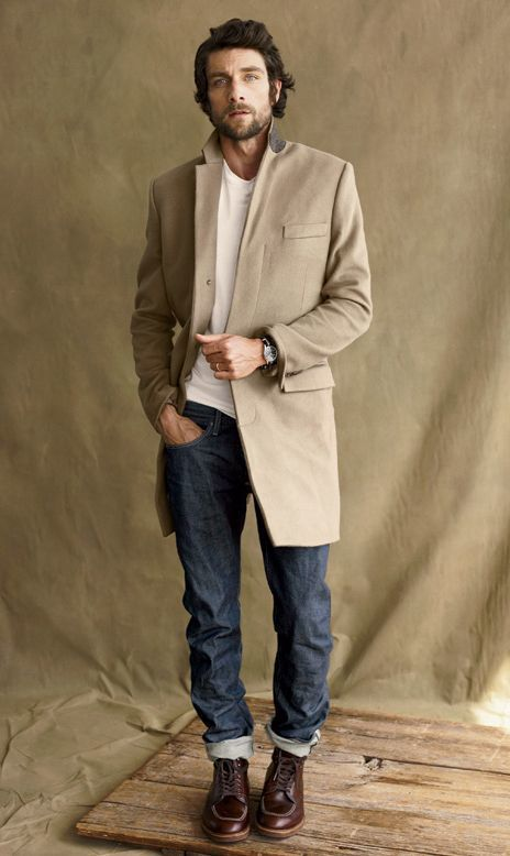 Perfect the smart casual look in a tan overcoat and dark blue jeans. Dark brown leather work boots will contrast beautifully against the rest of the look.   Shop this look on Lookastic: https://lookastic.com/men/looks/camel-overcoat-white-crew-neck-t-shirt-navy-jeans/18560   — White Crew-neck T-shirt  — Camel Overcoat  — Navy Jeans  — Dark Brown Leather Work Boots