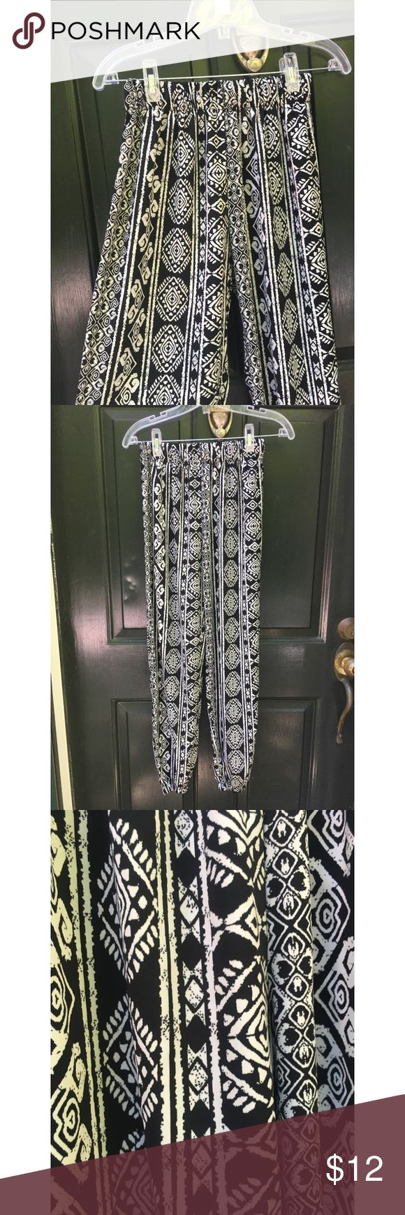 ✨ Black & White Boho Aztec Pattern Joggers - Black & White Boho Aztec Pattern Joggers - Awesome lightweight joggers from ambiance apparel/ local boutique called my best friends closet (feel free to Google)  - Great condition, worn once  - Elastic waist and elastic on each ankle  - Loose, flowy feel perfect for hot weather  - Brand: Ambiance Apparel/ Boutique - Size: M , true to size  *20% off 2+ * Make me an offer!! Boutique Pants