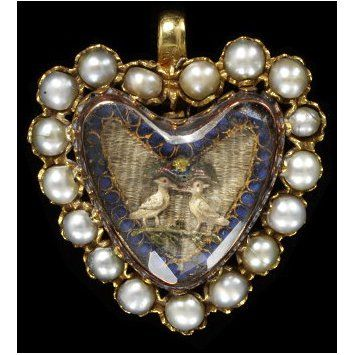 Gold pendant, the border set with half pearls surrounded by an embroidery of two birds under faceted crystal. ca. 1700