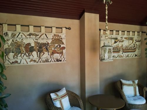 Bayeux Tapestry. This pair of tapestries, Mont St Michel and Navigio, are actually hanging outside (in the south of France). Today they are woven in Belgium in several sizes, lined with a rod pocket (the tabs were added by their owner).