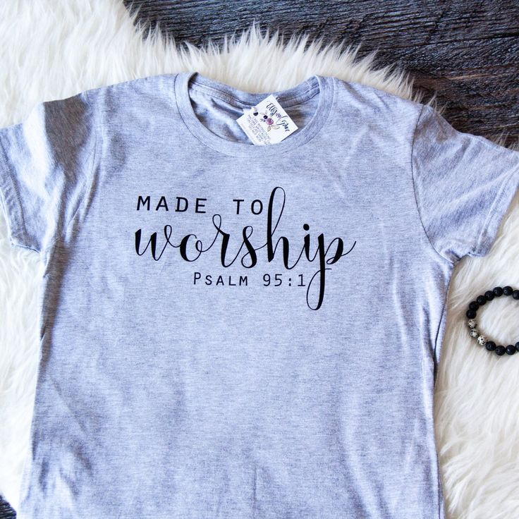 We were made to worship. this shirt is perfect for wearing to church, bible study or choir practice! Shown in the heather grey with black font.