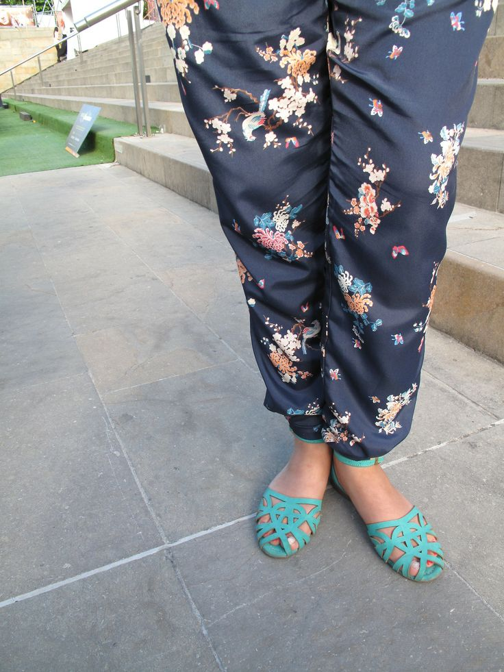 Street Chic: From the waist down Who said that the blouses and jackets had to have all the fun? You can still look amazing enfacing from the waist down, with silk, floral pants and a pair of mint web-like flats.