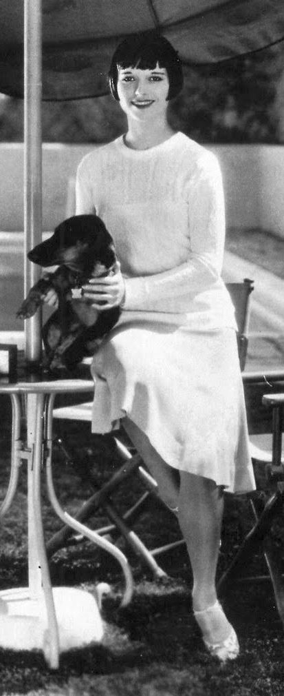 Louise Brooks circa 1928 - normally this is reserved for terriers and poodles, but I can always make an exception for Louise Brooks. And who doesn't love a dachshund?