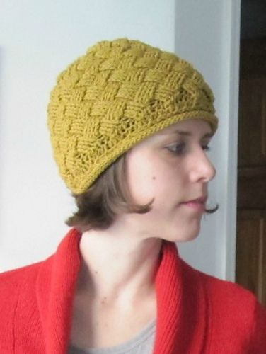 Nice idea- slant a basket weave stitch by placing the post stitches back (consistently) a few stitches.      Ravelry: Criss Cross Hat pattern by Katie Carroll