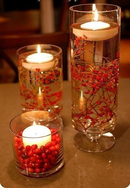 Floating Candles - Glass containers with red berries and floating candles
