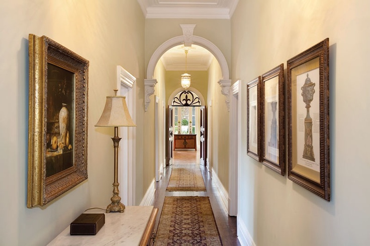Showcasing period details with 12 ft ceilings and polished boards, this property welcomes you with a wide arched hallway