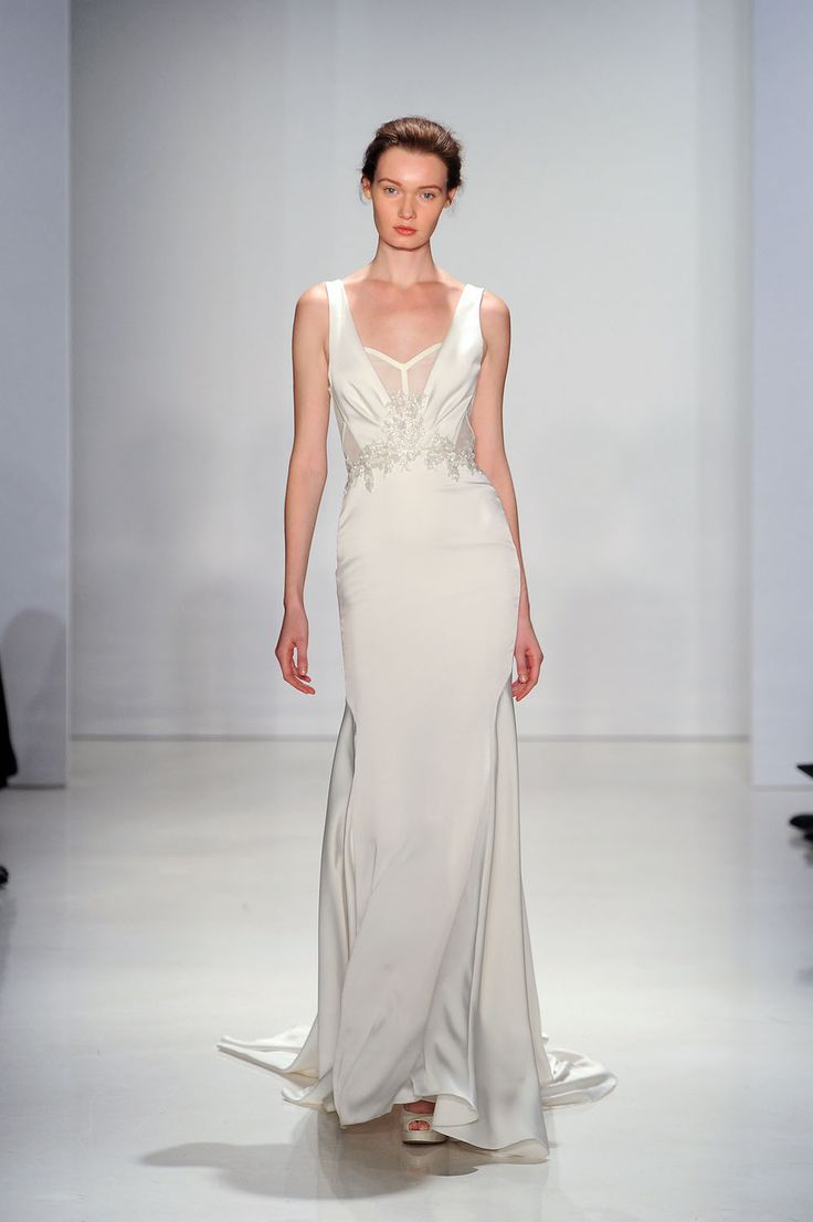 This new Kenneth Pool wedding dress offers a more modest alternative to the plunging V-neckline.