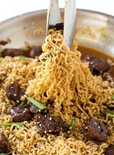 Mongolian Beef Ramen  1 pound rump steak, sliced against the grain and cut into ¼ inch cubes ⅛ cup cornstarch ½ tablespoon sesame oil ½ tablespoon canola or vegetable oil 3 cloves garlic, minced 1 teaspoon ginger, minced ½ cup low sodium soy sauce ½ cup water ¾ cup light or dark brown sugar oil for frying 10 ounce package dry ramen noodles sliced green onions for garnished, if desired