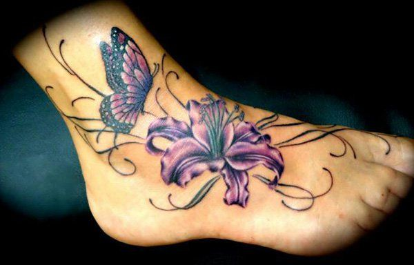 butterfly and lily tattoo on foot - 50 Awesome Foot Tattoo Designs <3 <3