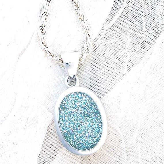 This a large 14X10mm oval Brazilian Drusy quartz pendant sparks so many colors its hard to count them all, and the side detail in the platinum is timeless. Even surface and color dispersal. 18 sterling silver rope necklace included. Quartz is known to lower stress and bring