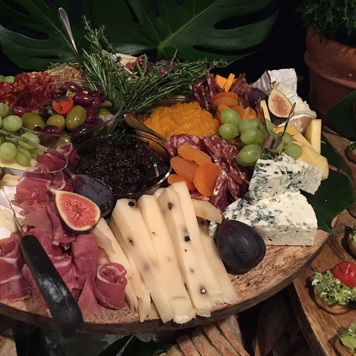 Beautiful and utilitarian, wood grained round board we use for displaying everything from artisanal cheese presentations to freshly baked bread. - Food Safe with Beeswax Finish - Dark Strap for Hangin