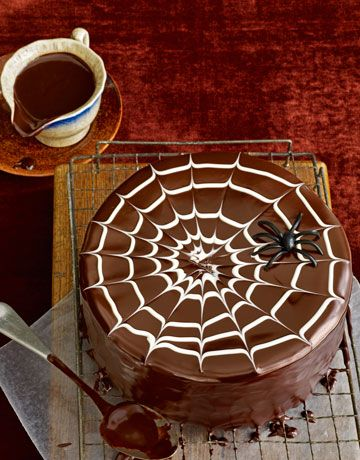I found this photo on a blog, but it's another Country Living cake. It looks like you could do the old make a circle with frosting and drag a toothpick through it trick to achieve this. I wish I had a piece of this now!