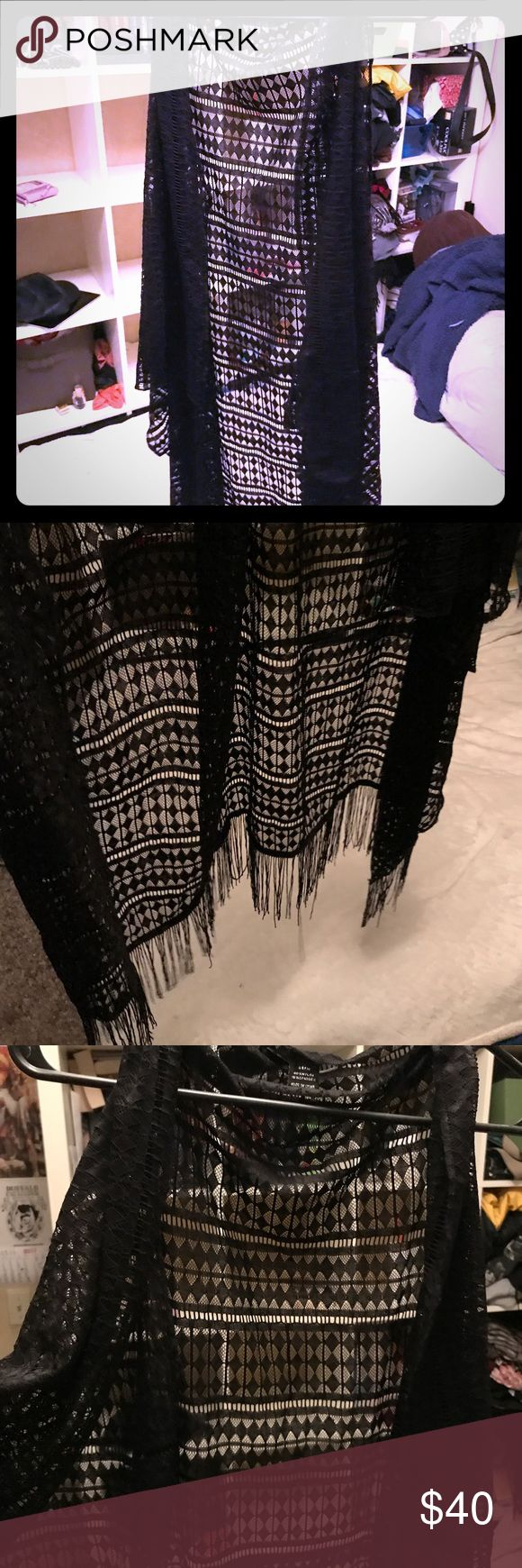 Black Fringe Kimono Vest by Cejon Great condition, only worn a few twice. As a garment it sits really nicely and the front falls like a vest. Good length, I'm 5'10 and it hits me at above the knee. The bottom obviously has fringe which I love. It's very light and airy, and goes well with everything. cejon Sweaters Shrugs & Ponchos