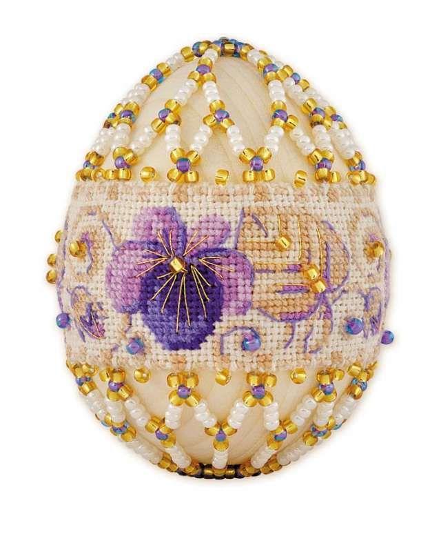 Cross stitch band beaded onto an egg