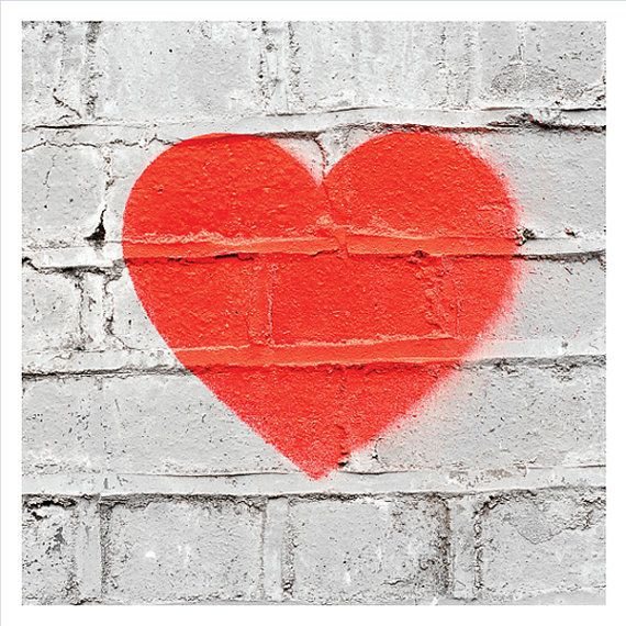 Red heart stencil graffiti art: white wall by EyeshootPhotography