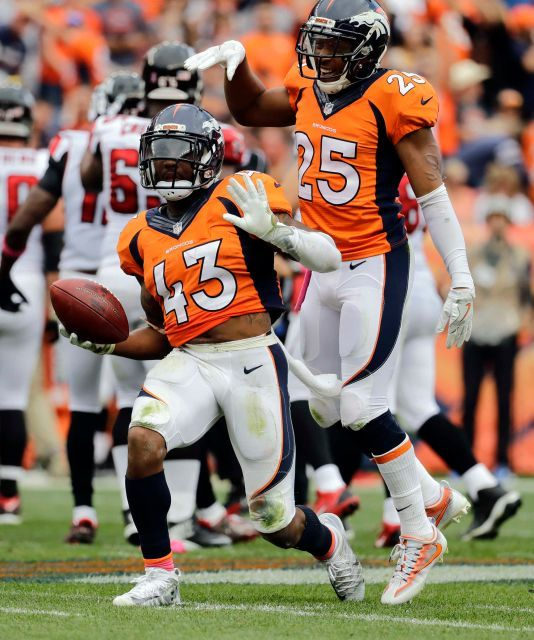 Falcons vs. Broncos:   October 9, 2016  -  23-16, Falcons.      Denver Broncos strong safety T.J. Ward (43) celebrates his take away against the Atlanta Falcons during the second half of an NFL football game, Sunday, Oct. 9, 2016, in Denver.
