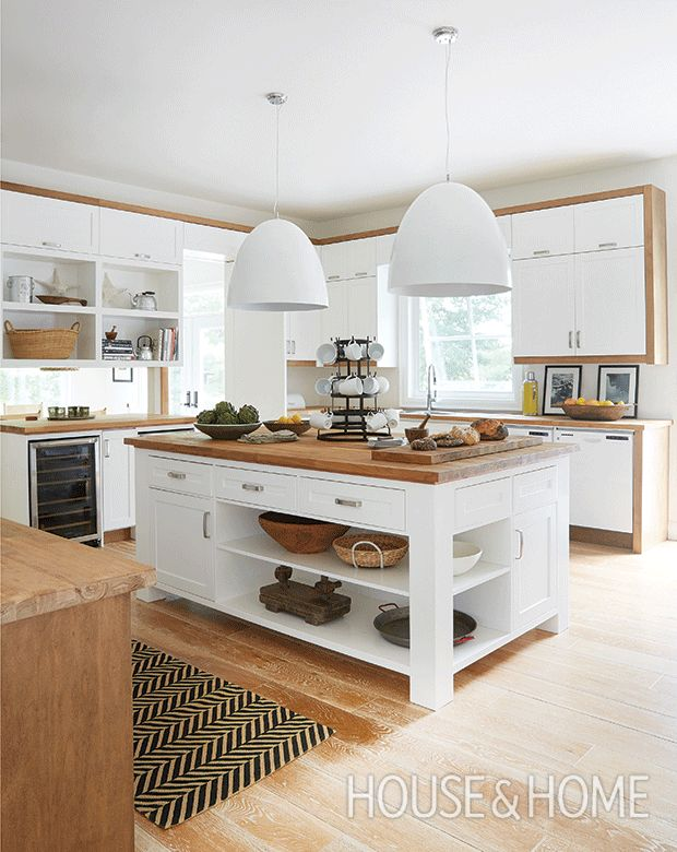 Coming in at number 10, this lakefront cottage kitchen with larger-than-life pendants has a soothing mix of white and wood. | Design: Montana Burnett | Photo: Virginia Macdonald