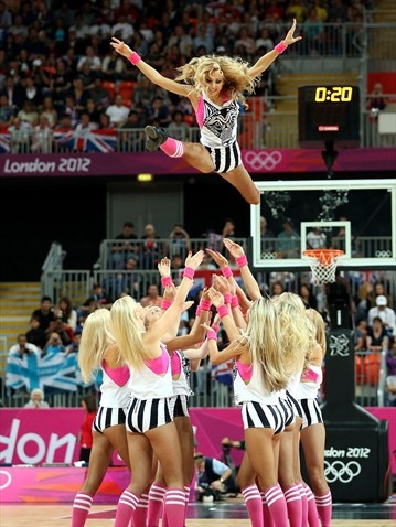 The Red Foxes dance team performs during a timeout between Great Britain and China during the men's Basketball preliminary round match on Day 10 of the London 2012 Olympic Games at the Basketball Arena on 6August.