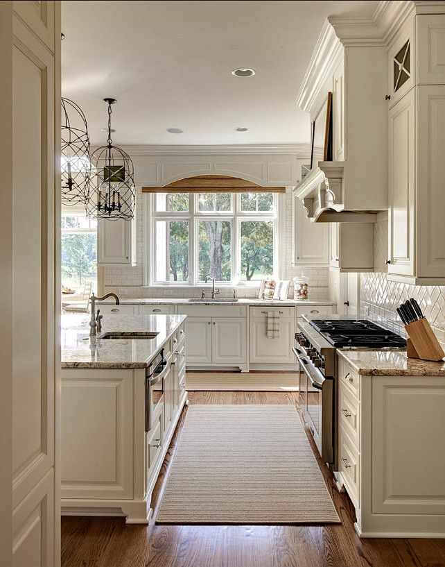 Kitchen window treatments. Love the custom front that follows the cabinet treatment. Adds a more cleaner look to shade over sink area.