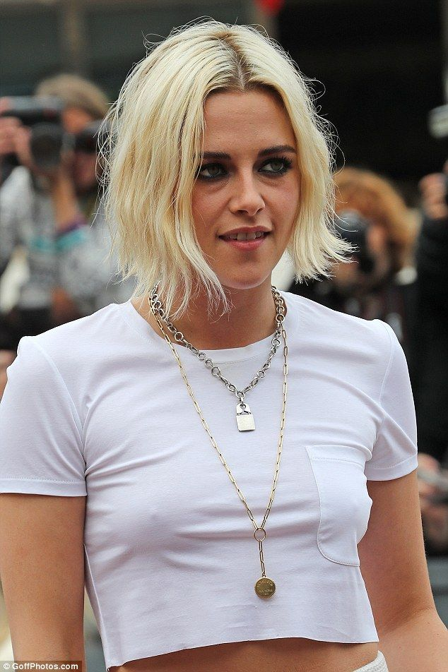 Grunge glamour:Kristen Stewart looked sensational in a white crop top and two stacked Sus...