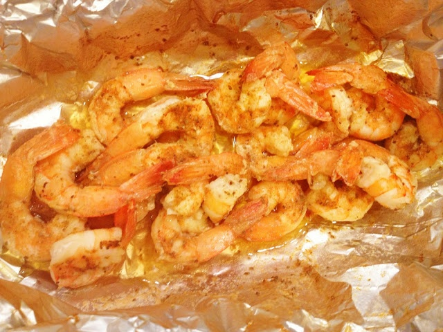 Steamed Shrimp in a foil pouch ON THE GRILL: Shrimp, Old Bay to your liking, couple pats of butter and a splash of lemon juice.  Seal foil pouch  grill for about 8-10min depending on the size of shrimp