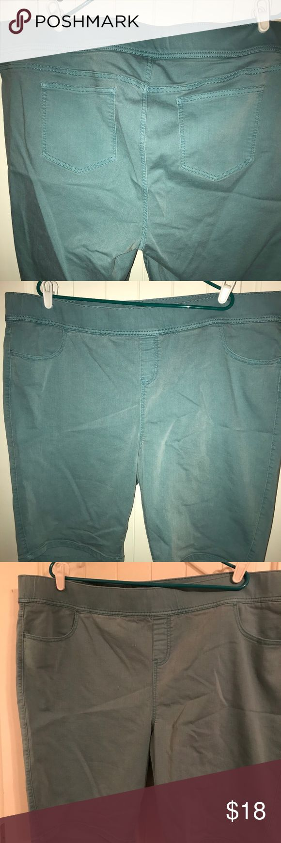 Torrid Lean Jean Bermudas 4x Torrid's lean jeans, as shorts!  Knee length, stretch denim in a light turquoise/green.  (It's a little more pastel than it looks in the pictures. Sorry. The light in my house is awful.)  Fit TTS, but if you're muffin-toppy, I suggest sizing up.  Has front pockets, but they're teeny.  Might hold a chapstick, not your phone.  These were worn once before I decided the length didn't work on me.  I'll bundle! Make offers! :D torrid Shorts Bermudas