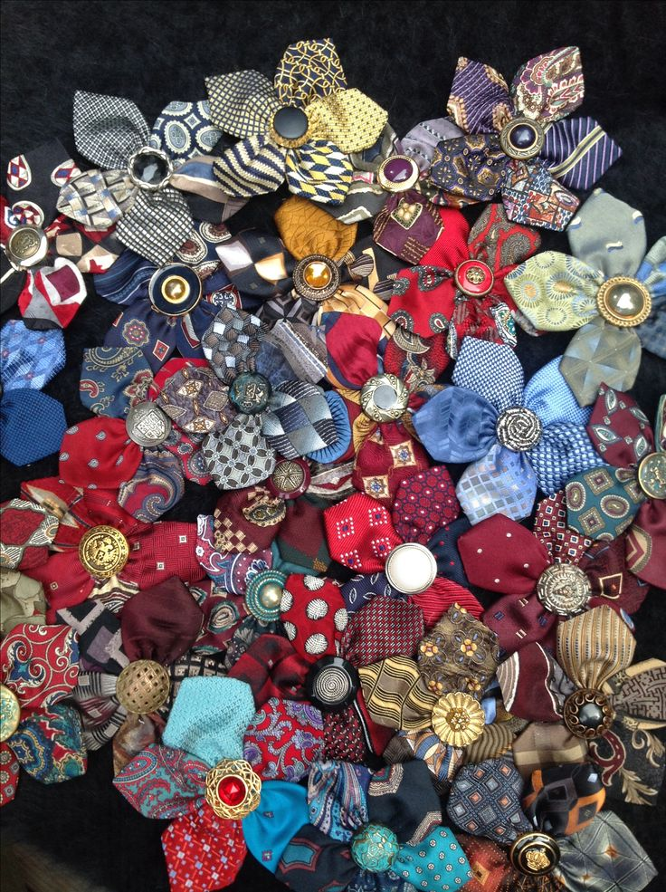 My flower pins made from silk neckties and vintage buttons.