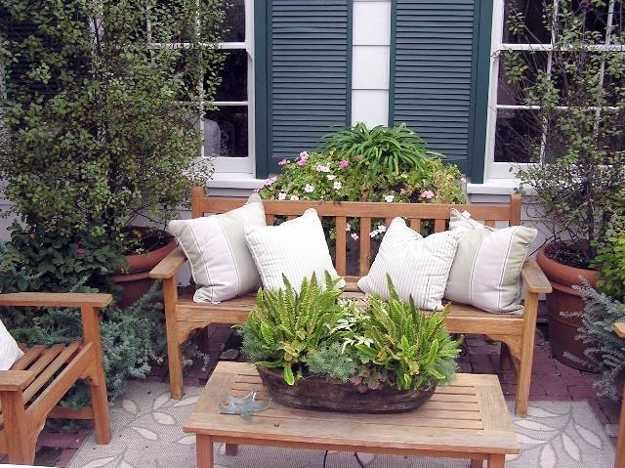 small patio design with wood furniture