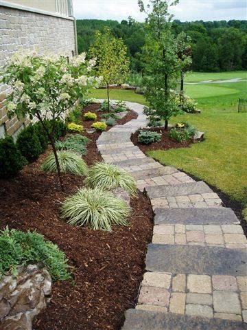 """The homeowner wanted a practical walkway that would enhance the side of the home.  The combination of functionality with garden accents created just the right look."""
