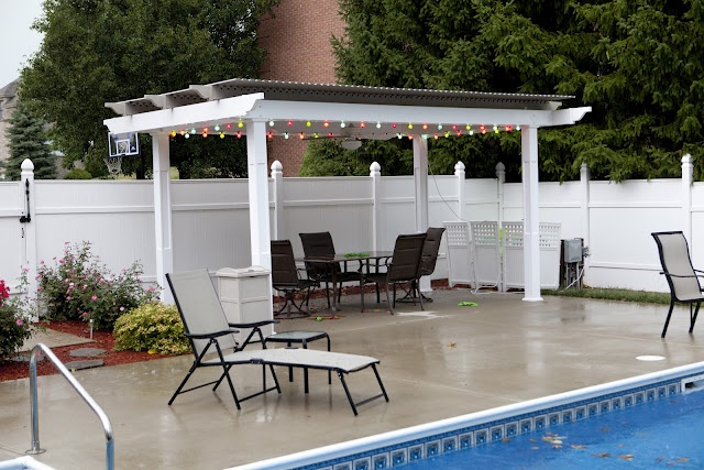 This patio cover made of extruded aluminum (stronger than rolled aluminum) is made by American Louvered Roof Systems.