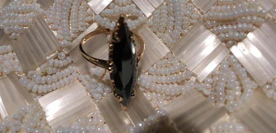 ANTIQUE - BLACK ALASKAN DIAMOND RING - MARQUISE SHAPED FACETED STONE APPROX. 3 cm LONG! 10k YELLOW GOLD in beautiful dainty antique setting. This ring is in excellent condition - no chips or cracks! Im sorry, I couldnt get a scan of the marking inside, but it is marked. Ive sold