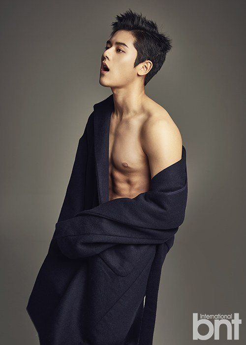 Dongjun bares his abs and more for 'International bnt' | allkpop.com