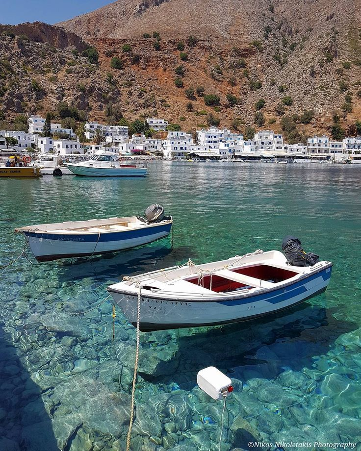 "The ""flying"" boats in Loutro. A picturesque village in North Crete with crystal clear waters . It's accessible only from the sea. Happy evening!"