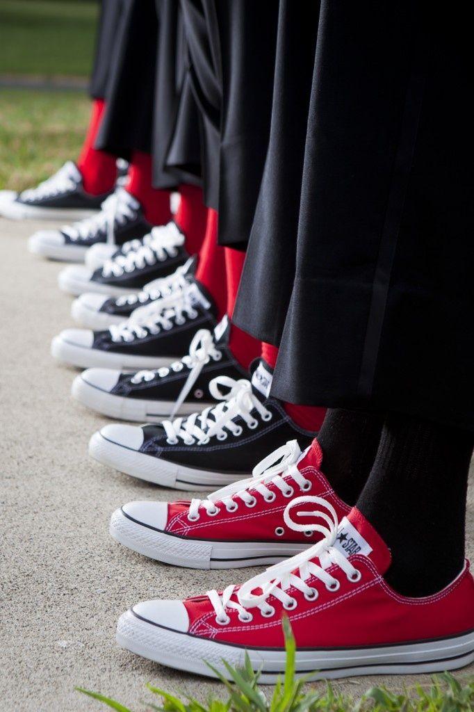 groom in red sneakers
