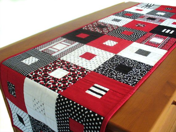 Quilted contemporary geometric table runner or wall hanging in red, black and white cotton. $138.00, via Etsy.