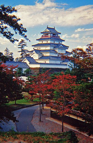 "Tsuruga-jo, Aizu Wakamatsu 福島 The reconstructed castle of Tsuruga-jo, or ""Crane Castle,"" most famous for appearing to burn in 1868 causing the Byakkotai, White Tiger Band, to kill themselves (save one), on a nearby hillside (Iimori-yama) because they thought their castle had fallen. In reality, the castle was only scorched and the fire was in the town. The Meiji government didn't raze the castle until 1874, a time when most castles were beginning to be eliminated."
