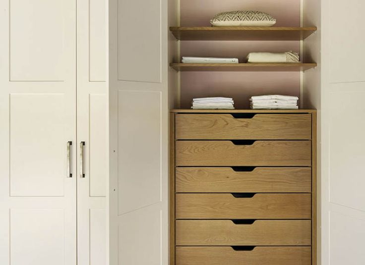 An interior detail from a John Lewis of Hungerford walk-in wardrobe project. Here a stack of oak drawers have been concealed behind wardrobe doors to create a neat storage area. http://www.john-lewis.co.uk/bedrooms/classic-artisan-bedroom