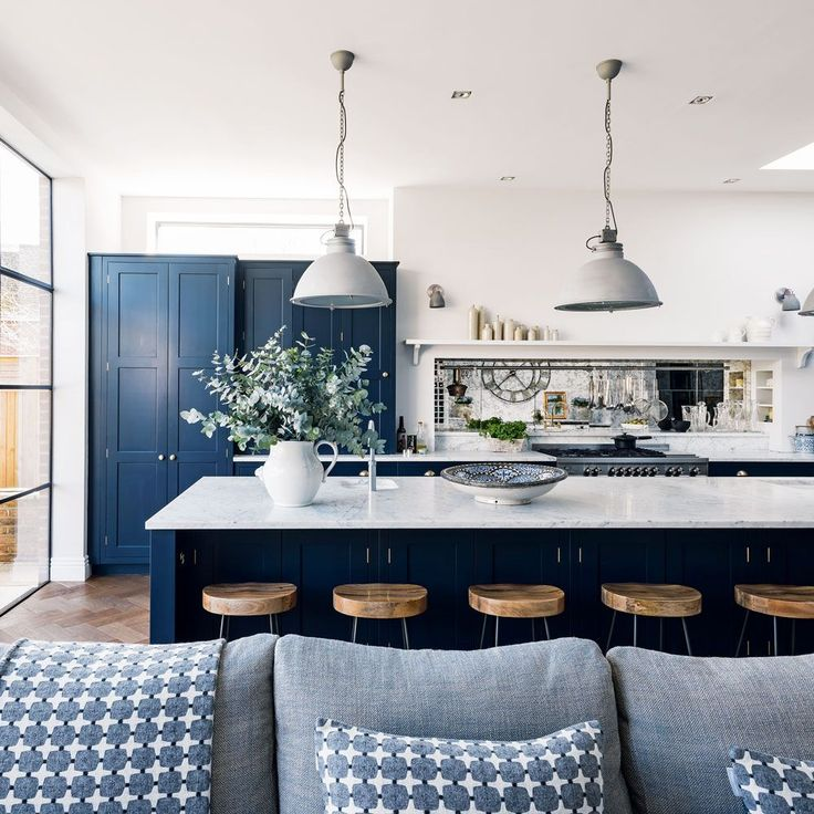 Modern blue and white open plan kitchen