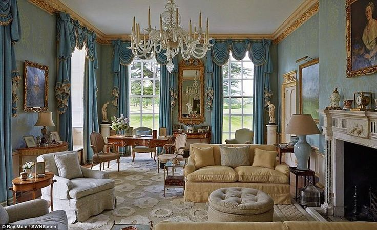 Large blue and gold sitting room with antiques and traditional style.